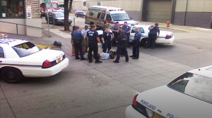 Portland Police Watching A Restrained Jim Chasse who was suffering multiple injuries.