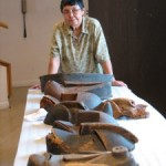 Alutiiq artist Helen Simeonoff w/masks discovered in France.