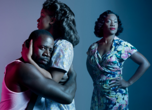 "L-R: Demetrius Grosse as Stanley, Kristen Adele as Stella and Deidrie Henry as Blanche in Portland Center Stage's upcoming production of ""A Streetcar Named Desire."""